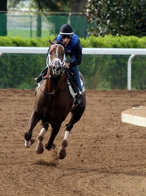 Carpe Diem, with John Velazquez abaord, goes for his morning workout | Keeneland Race Course on Saturday.