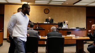 Basim Henry being led into court as the jury continues to deliberate Wednesday, March 29, 2017, Newark, N.J. Henry is one of four men charged in the death of Dustin Friedland.
