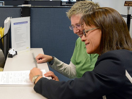 Karen Vibe, right signs her marriage license to Karen Goody, left. It was the first to be issued in Washoe County to the same sex couple, on Thursday Oct. 9, 2014.