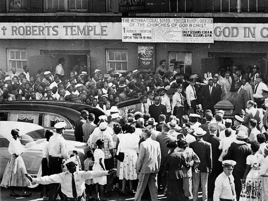 A large crowd gathers outside the Roberts Temple Church