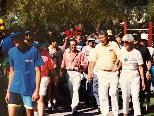 Palm Springs Mayor Sonny Bono (center) and his wife, Mary Bono, join participants at the Desert AIDS Walk in the early 1990s.