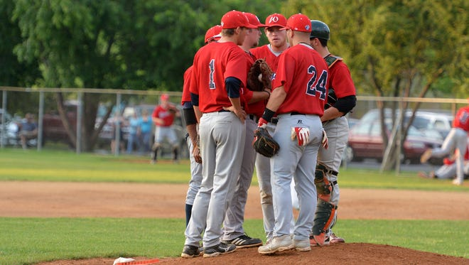 The Waynesboro Generals meet at the pitcher's mound during the first inning of a Valley Baseball League game.
