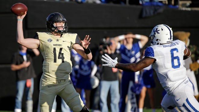 Vanderbilt quarterback Kyle Shurmur (14) passes as he is pressured by Kentucky defensive end Jason Hatcher (6) on Nov. 14, 2015.