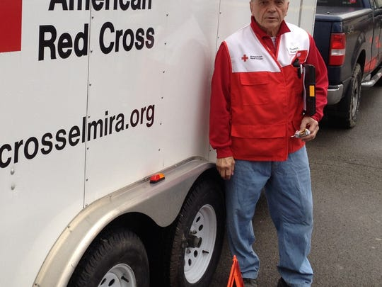 Red Cross Finger Lakes Chapter volunteer Vince Giannini of Elmira was in charge of getting the disaster trailer to the shelter set up Wednesday morning at North Presbyterian Church in Elmira. It contains 50 cots and 100p blankets, among other items.