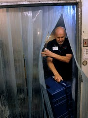 Ralph Goode emerges from one of the walk-in coolers at the Abilene United Supermarket's Market Street store Friday July 7, 2017. Goode was gathering orders for delivery as part of the store's Streetside program which brings groceries to customer's doors.