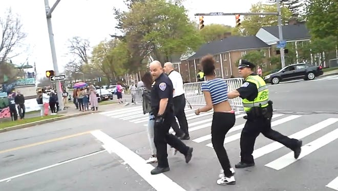 A Facebook video filmed by Marky Hutt at the Rochester Lilac Festival on Saturday, May 7, 2016, shows an apparent arrest in progress.