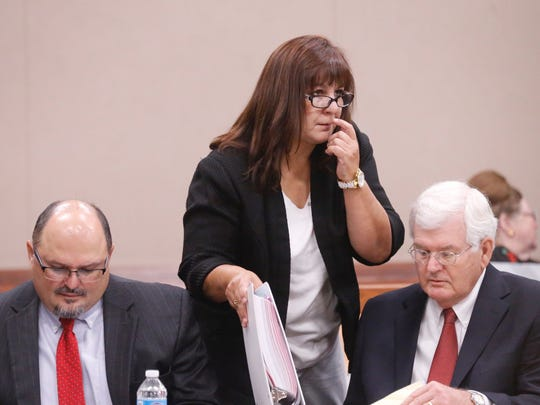 Anna Luisa Kell, standing, a former assistant principal at Bowie High School, is one of three former school administrators in court Monday for a hearing fighting sanctions or revocation of their education credentials for their alleged involvement in the EPISD cheating scheme.