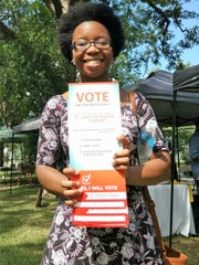 Young volunteer supports voter engagement at the 2016