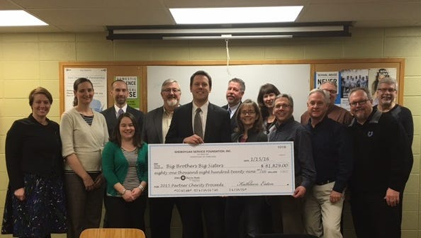 The Sheboygan Service Club presents a check to Big Brothers Big Sisters of Sheboygan County. Pictured: Back row from left: Sherry Wolff (SSC), Janine Chesebro (SSC), Mike Jonas, Tim Kaker, Stuart Huebner, Nancy Wagner, Bret Blizzard, Dave Hoffman; Front row from left: Mary Lovelien (SSC), Ryan Kautzer, Laurie Dawson, Brian Jenny, Gary Lacy,and Scott Kuehn.