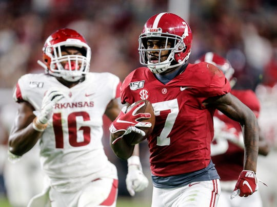 Oct 26, 2019; Tuscaloosa, AL, USA; Alabama Crimson Tide defensive back Trevon Diggs (7) returns an interception for a touchdown during the first half of an NCAA college football game at Bryant-Denny Stadium. Mandatory Credit: Butch Dill-USA TODAY Sports