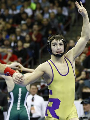 Two Rivers' Paul Bianchi celebrates his winning over Kewaskum's Eric Bauer during Division 2 state championship match Saturday, February 27, 2016, at the Kohl Center in Madison. T'xer Zhon Kha/USA TODAY NETWORK-Wisconsin