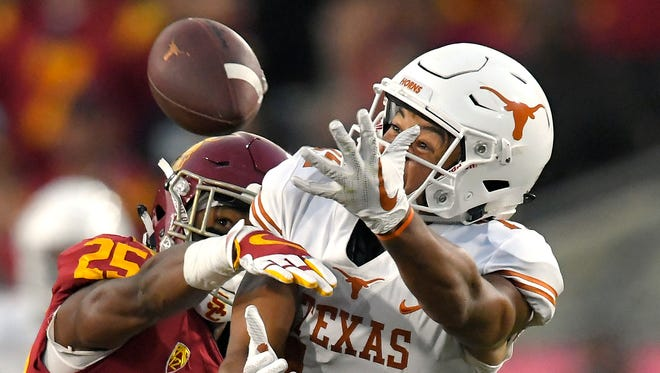 Texas wide receiver Lorenzo Joe, right, can't get to a pass intended for him while under pressure from Southern California cornerback Jack Jones during the first half of an NCAA college football game, Saturday, Sept. 16, 2017, in Los Angeles.