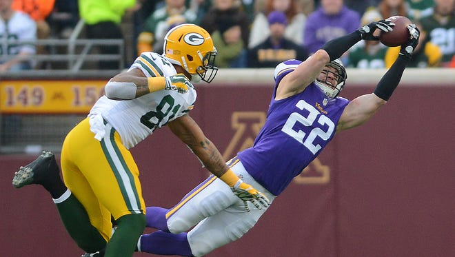 Green Bay Packers tight end Andrew Quarless (81) watches as safety Harrison Smith (22) makes a play on an errant Aaron Rodgers pass against the Minnesota Vikings at TCF Bank Stadium November 23, 2014.