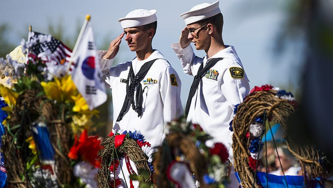 Memorial Day was observed at the National Memorial Cemetery of Arizona on May 29, 2017. Kyle Vonnahme, 14, left, and Aaron Cartland, 16, of the Naval Sea Cadet Corps Phoenix Division, salute during the  Placing of Wreaths ceremony.
