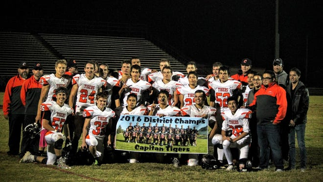 The Capitan Tigers earn a Class 3A District 4 championship over Eunice Nov. 4.