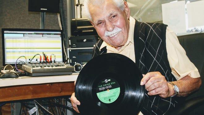 "Local radio DJ Ron Johnson shows off one of his personal vinyls at his studio at KRSY ""Alamo AM"" 1230 radio station."