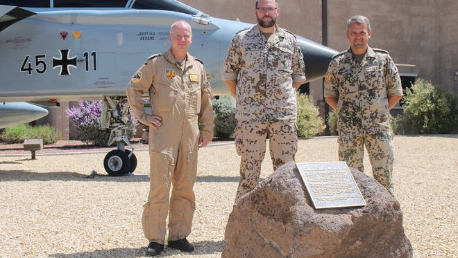 Commanding Director of the German Air Force Flying Training Center (GAFFTC) Col. Stephan Breidenbach (far left) stands with members of the German air force in front of the GAF aircraft, the Tornado, as they prepare for the 21st anniversary and final Oktoberfest at Holloman Air Force Base, Aug. 26.
