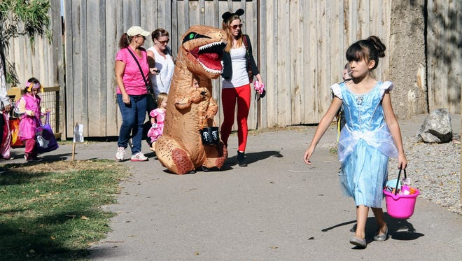 In this file photo, children trick-or-treat at this year's Zoo Boo at Alameda Park Zoo Saturday, Oct. 21.