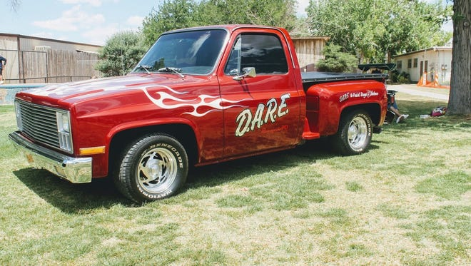 In this 2017 file photo, a vintage truck with the D.A.R.E. logo is parked at Alameda Park Zoo during the Alamogordo Police Department's annual D.A.R.E. picnic and graduation for Otero County's fifth-graders.