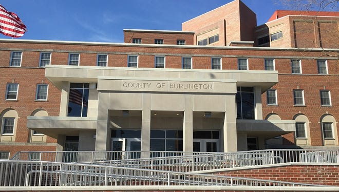 Burlington County has fired four jail officers after surveillance video showed they were skipping patrols.