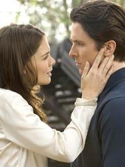 "Katie Holmes and Christian Bale star in ""Batman Begins."""