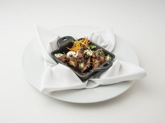 Poutine, inspired by the Canadian standard, features duck, crisp taters, cheddar cheese curds and port wine demi-glace.
