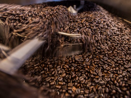 Roasted beans cool off at Gold Ladder Coffee off Susie