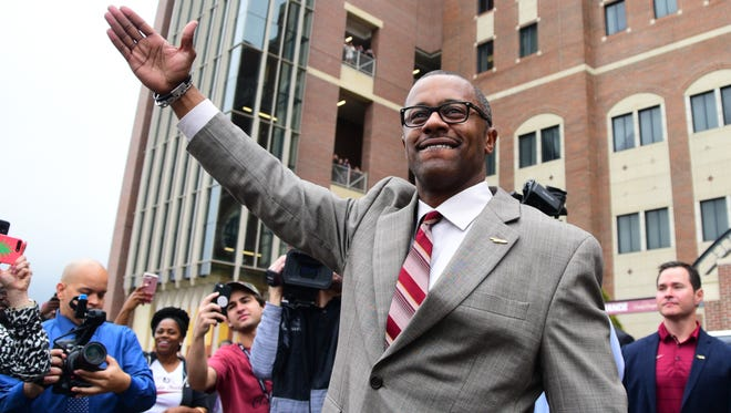 "Florida State's new head coach Willie Taggart does ""the chop"" outside of Doak Campbell Stadium on Wednesday morning."
