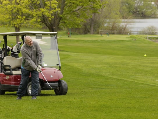Claude Collins hit a shot to the 9th green Tuesday,