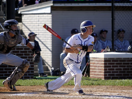 Waynesboro's Cody Cline hits a two-run single in the fourth inning against Chambersburg. The Indians won, 7-5.