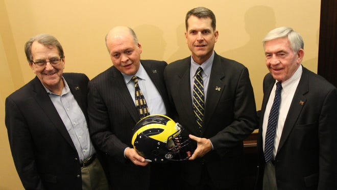 Jim Hackett with Michigan head football coach Jim Harbaugh on Dec. 30, 2014.