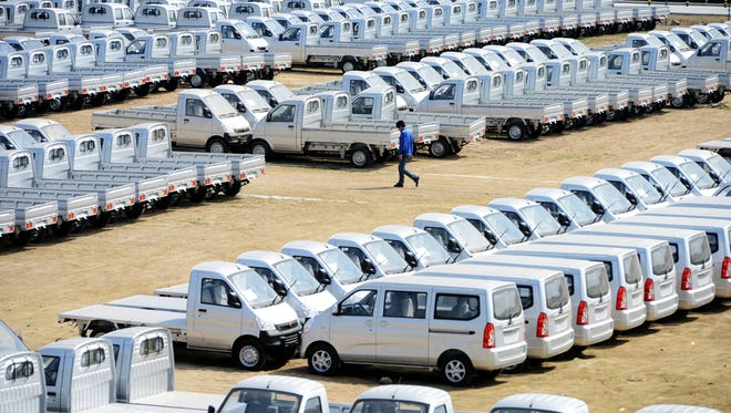 A parking lot filled with newly produced cars in SGMW's manufacturing base in Qingdao, in east China's Shandong province.
