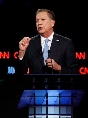 Republican presidential candidate John Kasich speaks during the Republican presidential debate sponsored by CNN, Salem Media Group and the Washington Times at the University of Miami in Coral Gables, Fla.
