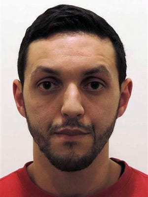 """This is an undated photograph provided by Belgian Federal Police shows Mohamed Abrini.  Belgian authorities say several arrests have been made in relation to the Brussels attacks. The prosecutor's office said Friday April 8, 2016 that it made """"several arrests"""" Friday, one day after it called on the public to help look for a key suspect in the March 22 attacks that killed 32 people. Belgian broadcaster VRT, citing sources it did not identify, said Paris attacks suspect Mohamed Abrini was among those arrested."""