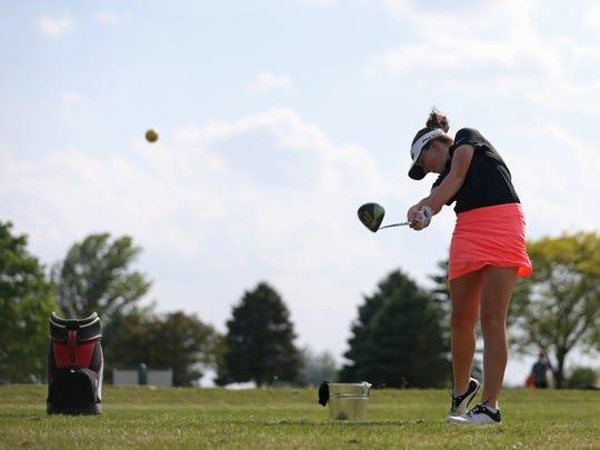 Britta Snyder, a freshman at Gilbert High School tees