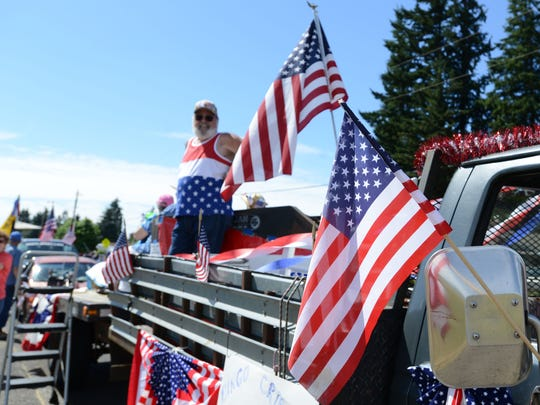 The Stayton Fourth of July parade rolls through town on Friday, July 4, 2014.