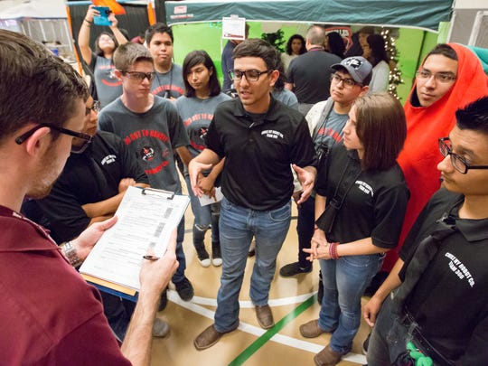 Exhibit and interview judge Jordan Johnson talks with students from Hatch High School on Saturday, October 21, 2017, during the 16th annual NM BEST Robotics Competition at New Mexico State University's James B. Delamater Activity Center.