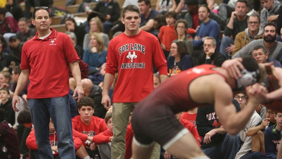 From left, Fox Lane wrestling coach Anthony Rodrigues