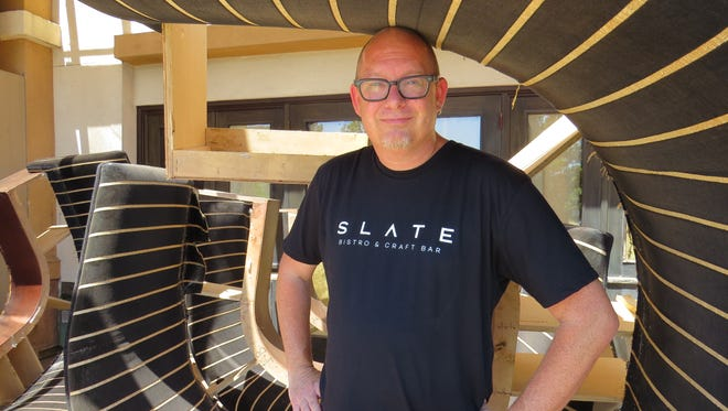 Camarillo restaurateur  Vince Pillard strikes a pose among booths removed from the dining room at the former Safire American Bistro. He plans to open Slate Bistro + Craft Bar in its place this fall.