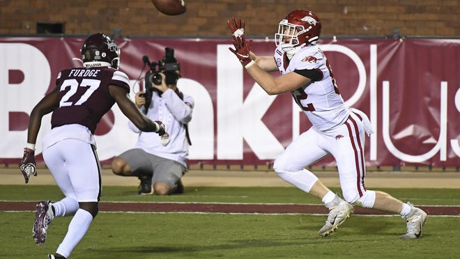 Arkansas tight end Hudson Henry (82) catches a 12-yard touchdown pass during the second half against Mississippi State in Starkville, Miss., Oct. 3. Arkansas won 21-14.