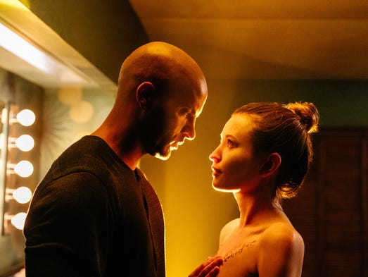 Shadow Moon (Ricky Whittle) and his wife Laura (Emily