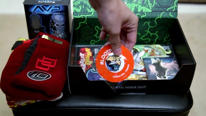 """This unboxing of the March 2016 """"Versus"""" theme Loot Crate reveals assorted items from Aliens vs. Predator, Batman vs. Superman, Star Trek, Daredevil and Punisher."""