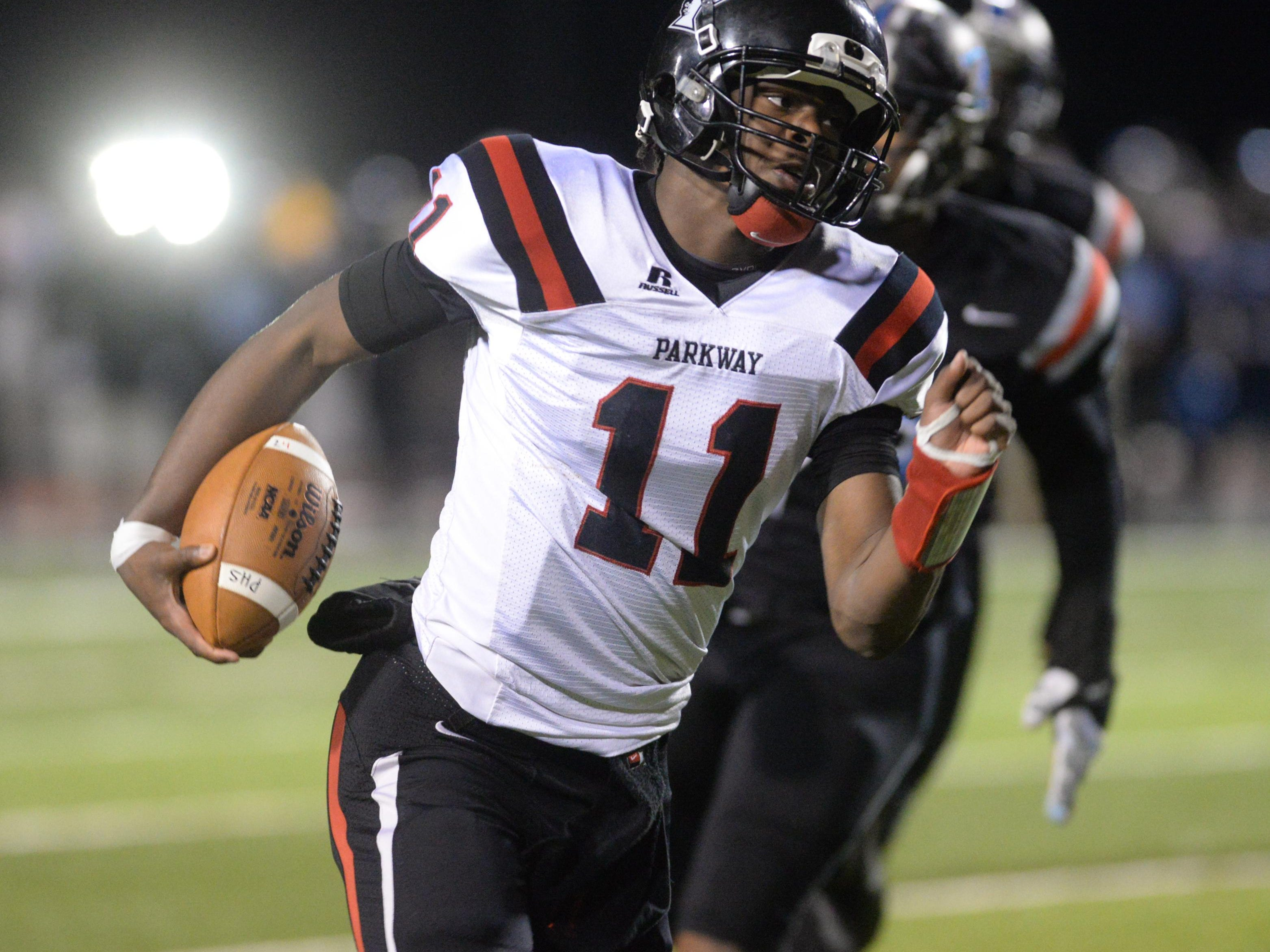 Parkway senior QB Keondre Wudtee runs for a first down against Zachary in the class 5A semifinals.