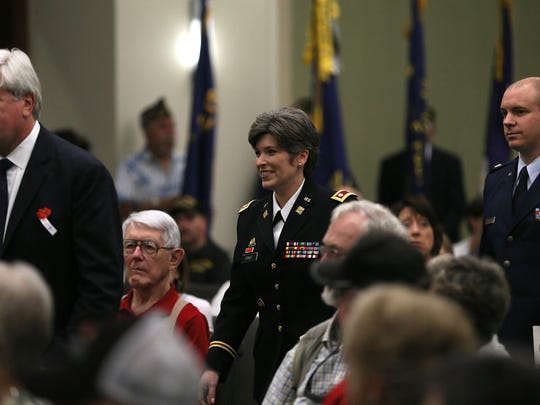 State Sen. Jack Hatch, Lt. Col. Joni Ernst and Col. Kevin Heer walk toward the podium during a Memorial Day program at Veterans Memorial Community Choice Credit Union Convention Center in May 2014.