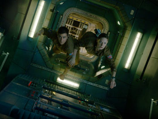 "In this image released by Sony Pictures, Jake Gyllenhaal, left, and Rebecca Ferguson appear in a scene from, ""Life."""
