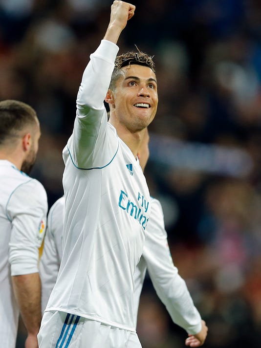 Real Madrid's Cristiano Ronaldo celebrates after scoring his third goal during a Spanish La Liga soccer match between Real Madrid and Girona at the Santiago Bernabeu stadium in Madrid, Spain, Sunday, March 18, 2018. (AP Photo/Paul White)