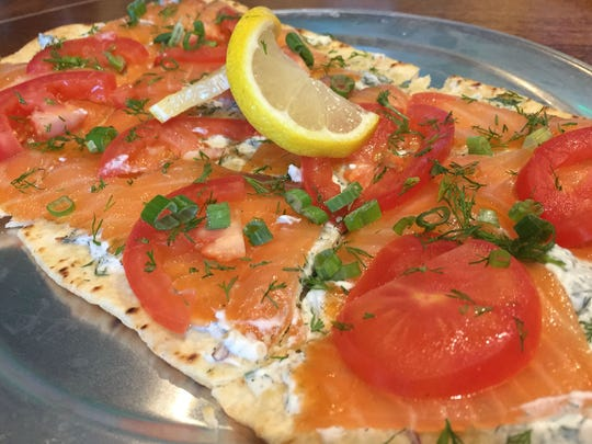 Dill shallot crème fraiche tamed the salmon's light smokiness on Flix's smoked salmon flatbread.