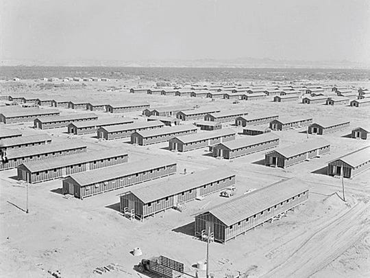 Poston, Arizona. Living quarters of evacuees of Japanese ancestry at this War Relocation Authority center as seen from the top of water tower facing south west. 06/01/1942