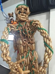 A wearable Groot balloon sculpture made by Tim Thurmond,
