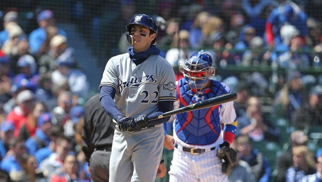 Brewers outfielder Christian Yelich strikes out Saturday against José Quintana.